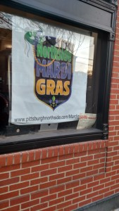 Allegheny City proudly displayed a sign out front to advertise that they were a part of the North Side's Mardi Gras celebration.